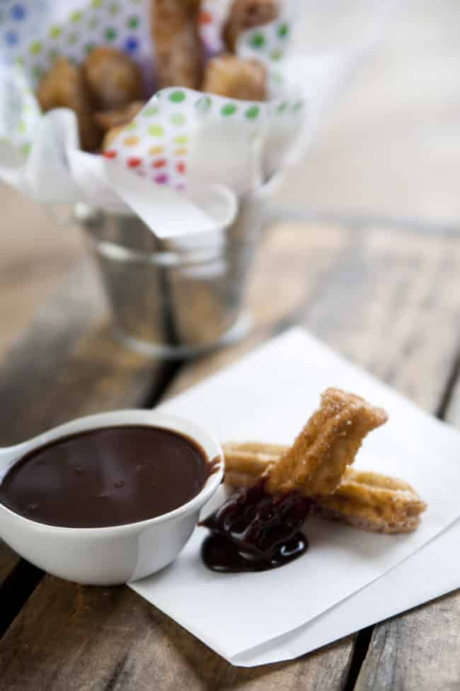 Churros & Mexican Chocolate Dipping Sauce - Crispy on the outside, soft, warm and chewy on the inside - these sweet churros are a dessert favorite. Especially with this amazing Mexican chocolate dipping sauce!