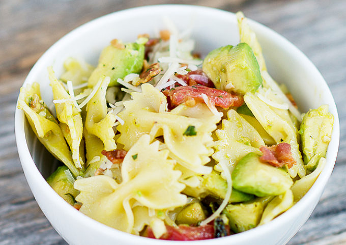 Avocado Basil Pasta Recipe - Utilize those fresh flavors of summer in this simple and light pasta dish featuring tomatoes, avocado, basil, bacon and parm.