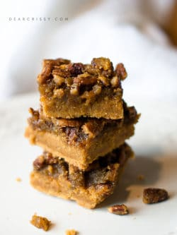 Pumpkin Praline Bars - If you're looking for a quick and easy pumpkin treat, this recipe is for you! One bite and you'll be hooked on these pumpkin praline bars.