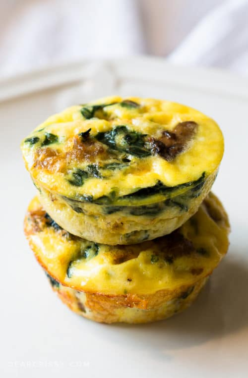 Mini Sausage & Veggie Quiches - These mini crustless quiches are savory and delicious. Plus, they feature nutritious, better-for-you ingredients like turkey sausage, spinach, mushrooms and reduced fat cheese! Scrumptious, quick and easy..