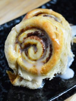 Pumpkin Cinnamon Rolls - These quick and easy pumpkin cinnamon rolls area easy to make in just about 25 minutes using a secret ingredient!