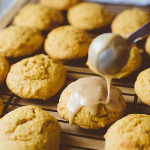 Buttery Pumpkin Cookies with Brown Sugar Icing - These soft, buttery pumpkin cookies are like sweet pillows of pumpkin flavor. The brown sugar icing sends them over the top! Pin this now so you don't forget about this amazing pumpkin recipe!