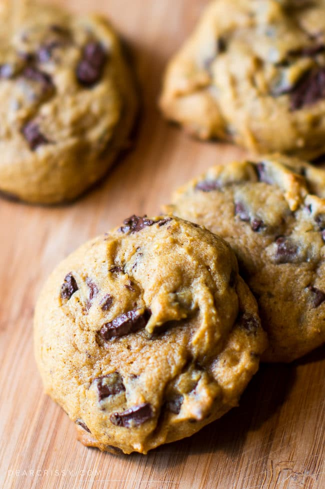 Pumpkin Chocolate Chunk Cookies - Everything you love about soft chocolate chip cookies all wrapped up in pumpkin flavored deliciousness!