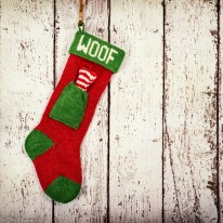 Christmas stocking for a dog against vintage wood