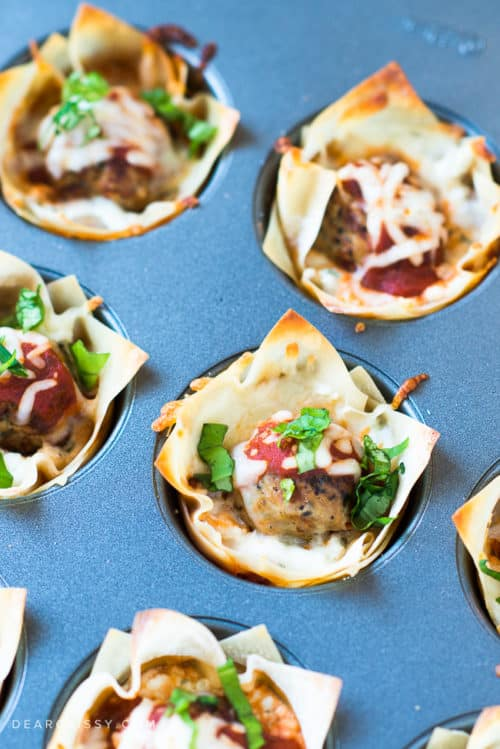 Mini Meatball Lasagna Cups - This easy appetizer is perfect for game day or any time you want to enjoy a delicious, cheesy lasagna bite!