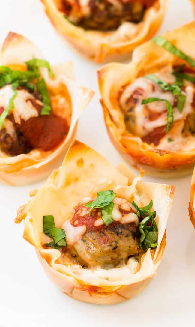 Mini Meatball Lasagna Cups Recipe - This easy appetizer is perfect for game day or any time you want to enjoy a delicious, cheesy lasagna bite!