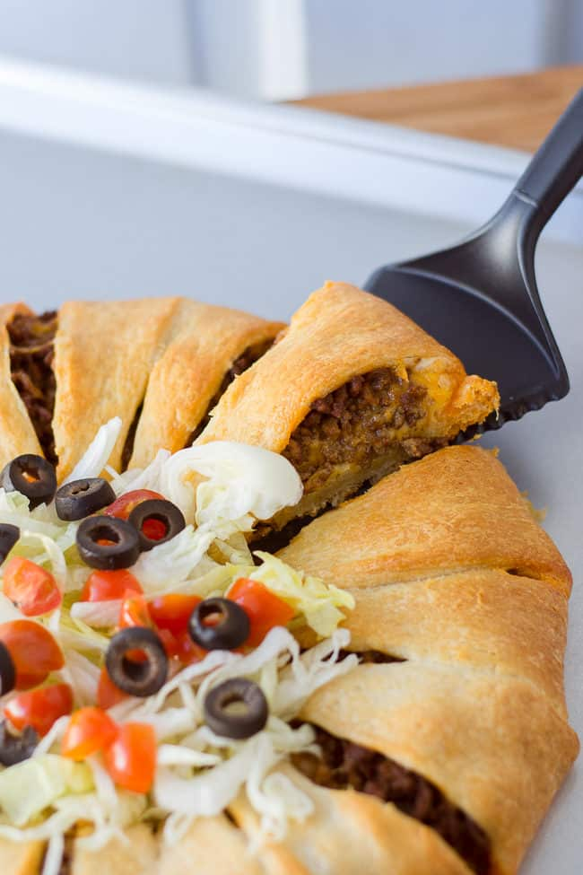 Taco Crescent Ring - This is such an easy and delicious family dinner idea featuring Pillsbury Crescents. My kids love it when I make the taco crescent ring for dinner!