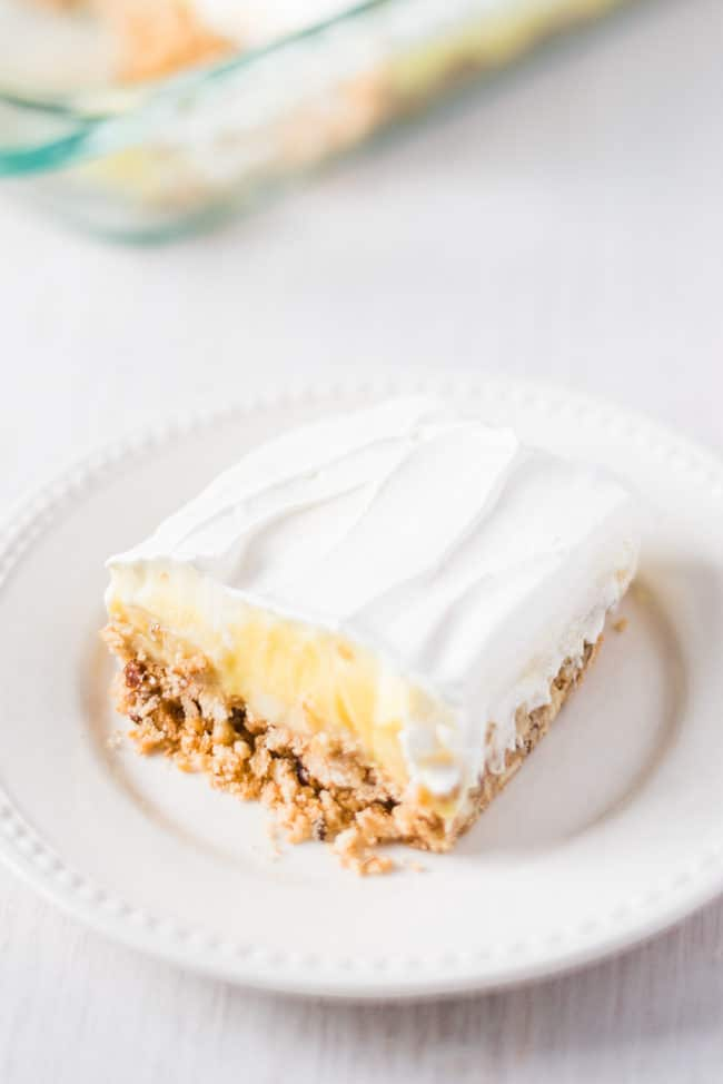Triple Layer Banana Cream Pie - Sweet, cool and creamy layers make up this divine dessert, and a crispy pecan and vanilla wafer crust sends it over the top!