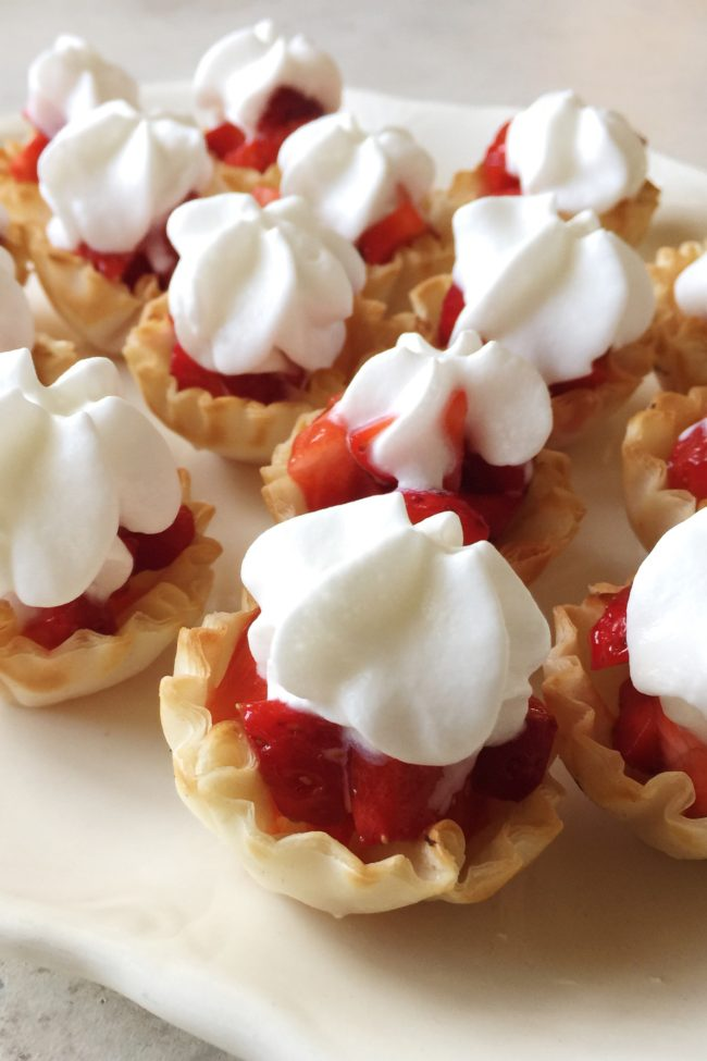 Mini Strawberry Bites - These sweet little strawberries n' cream fillo cups are delicious and super simple to make in just minutes!