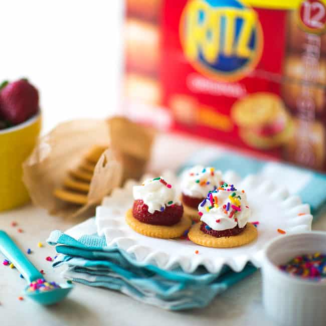 RITZ Cracker Strawberry Bites - Whip up these delicious little bites in minutes by topping RITZ Crackers with fresh strawberries, whipped cream and sprinkles. So cute, crispy and simply delicious!