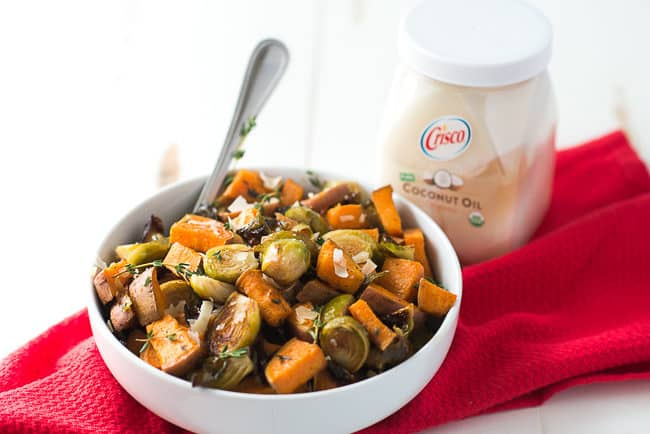 Roasted Sweet Potatoes and Brussels Sprouts - While roasted sweet potatoes with Brussels sprouts may sound like a strange combo, these veggies are a match made in foodie heaven! Finish with grated parmesan cheese for a delicious side dish.