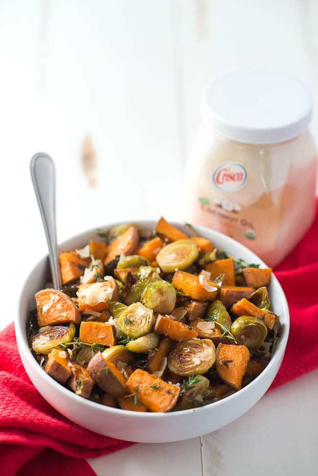 rRoasted Sweet Potatoes and Brussels Sprouts - While roasted sweet potatoes with Brussels sprouts may sound like a strange combo, these veggies are a match made in foodie heaven! Finish with grated parmesan cheese for a delicious side dish.
