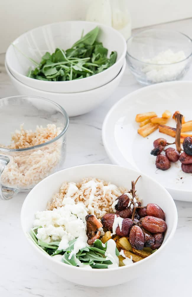 Roasted Grape, Arugula and Goat Cheese Buddha Bowl - A delicious and healthy bowl with creamy dressing looks as good as it tastes. This healthy Buddha bowl is a great clean eating lunch or dinner!