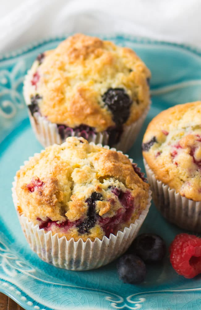 These easy berry muffins are moist and delicious thanks to the sour cream in the batter. This is a really easy muffin recipe that I know you'll love as much as I do!