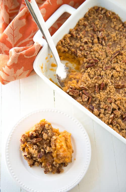 Sweet Potato Casserole with Pecan Brown Sugar Topping - Is it a side dish, is it a dessert? Who cares! It's delicious and perfect for your Thanksgiving table.