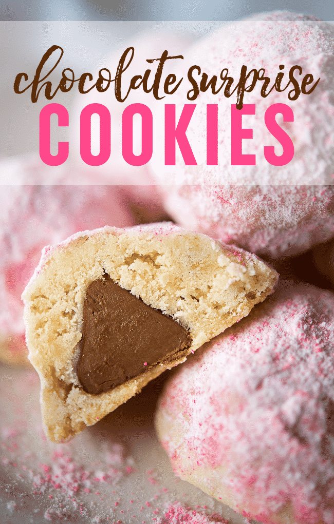 Chocolate Surprise Cookies - These pretty pink snowball style cookies have a chocolate surprise waiting inside!