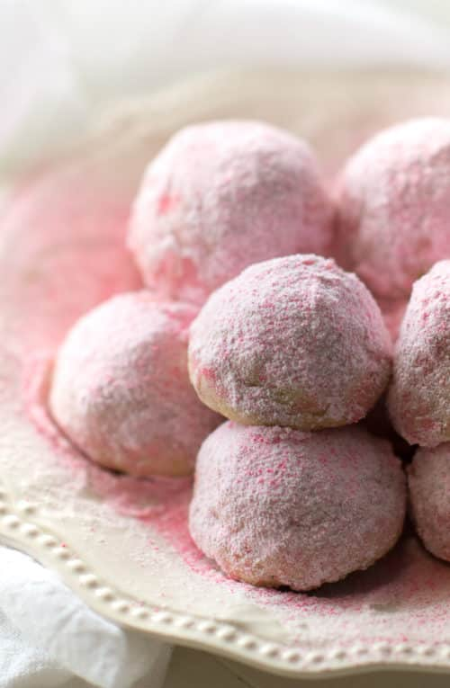 Secret Kiss Cookies - Pink Valentine's Day snowball-style cookies with a hidden Hershey's Kiss inside!