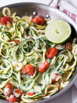Creamy Zoodles Recipe - Fresh zucchini noodles with a creamy avocado cilantro sauce and blistered tomatoes.