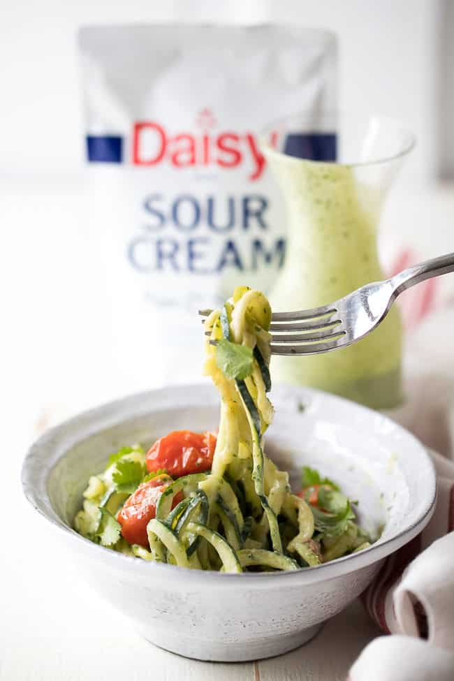 Creamy Avocado-Cilantro Zoodles Recipe - Fresh zucchini noodles with a creamy avocado cilantro sauce and blistered tomatoes.