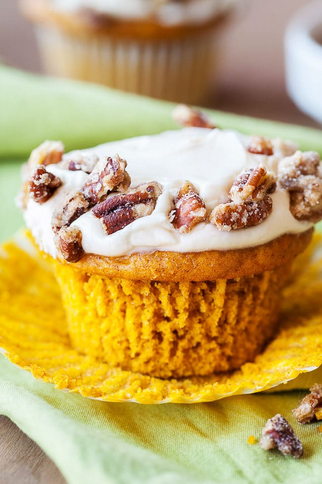 Spiced Pumpkin Cupcakes with Candied Pecans - Make these easy pumpkin cupcakes with a cake mix and a little pumpkin magic!