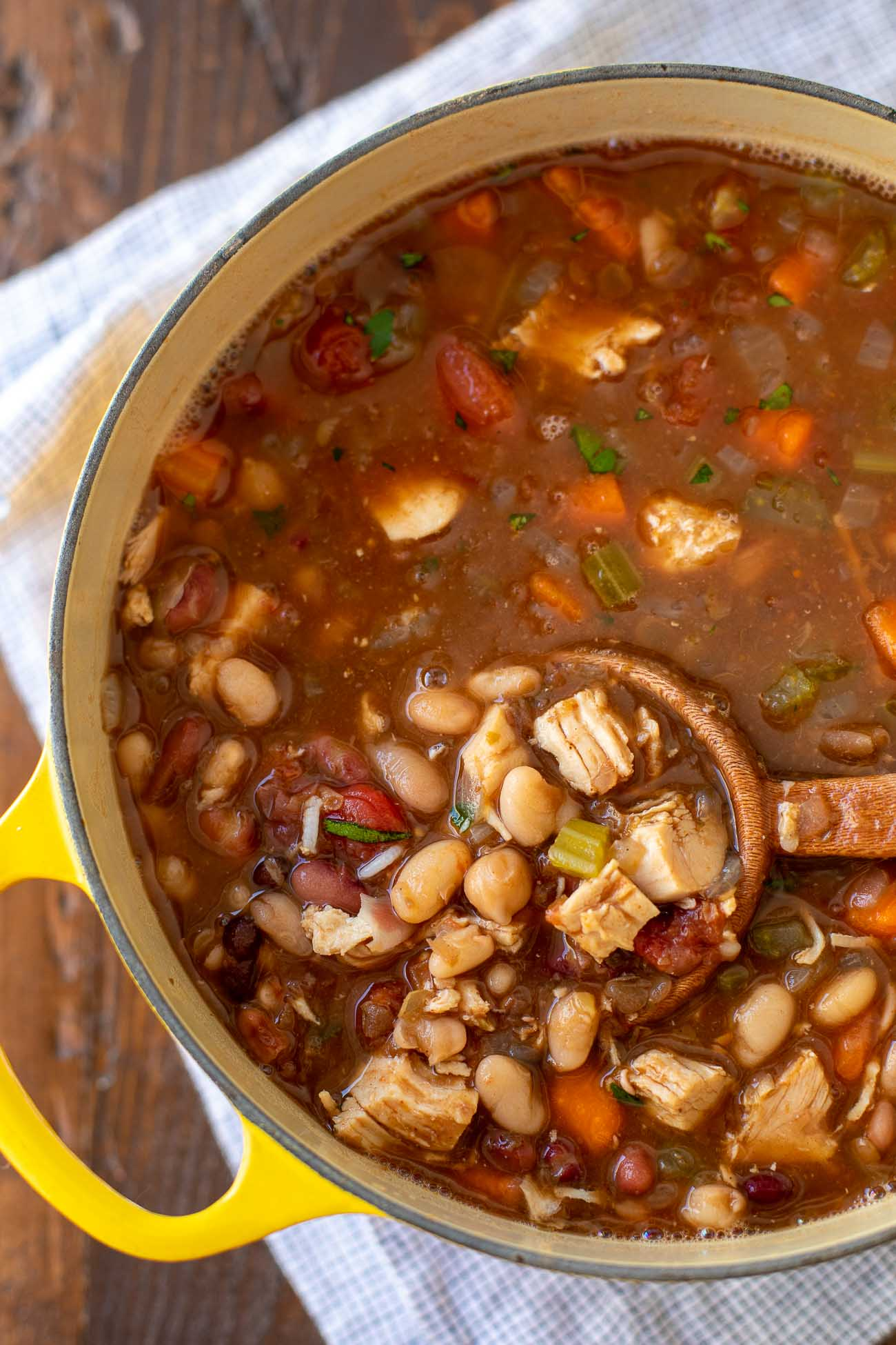 Cajun 15 Bean Soup with Leftover Turkey Recipe - you're going to love this warm and comforting bean soup with turkey recipe! #soup #beans #turkey